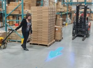 Blue Arrow On Floor