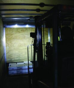 A forklift loading a truck.